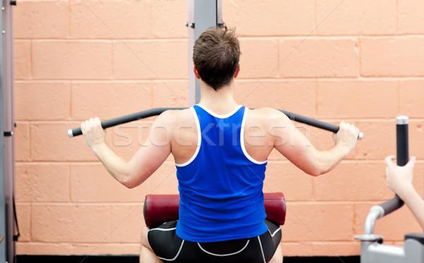 Charismatic male athlete practicing body-building Stock photo © wavebreak_media