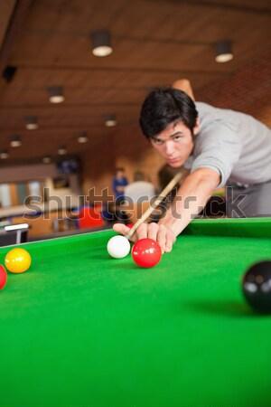 Konsantre genç oynama snooker kulüp el Stok fotoğraf © wavebreak_media