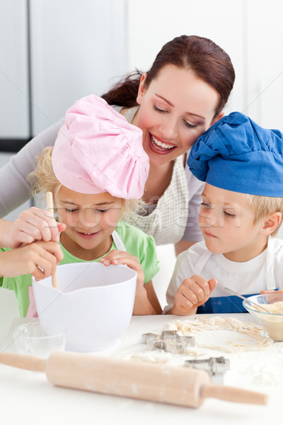 Mother with her children baking together in the kitchen to make cookies Stock photo © wavebreak_media