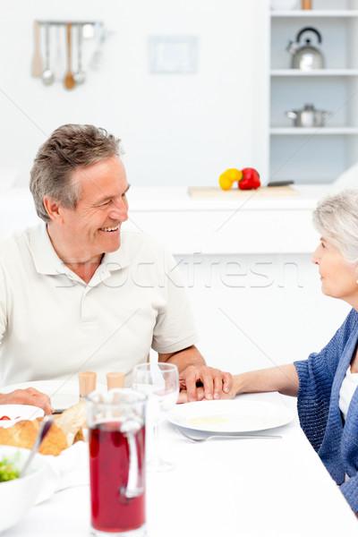 Nyugdíjas pár eszik konyha ház mosoly Stock fotó © wavebreak_media