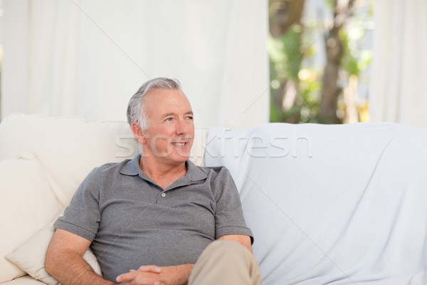 Senior sitting  in his sofa Stock photo © wavebreak_media