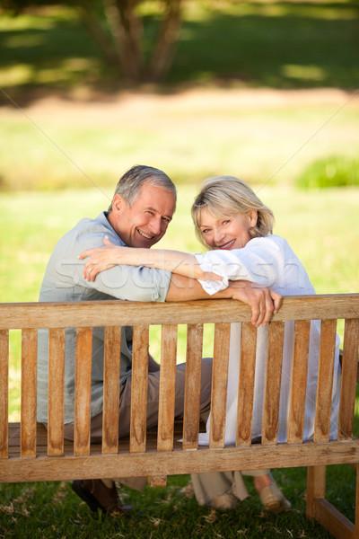 Boldog nyugdíjas pár ül pad fű Stock fotó © wavebreak_media