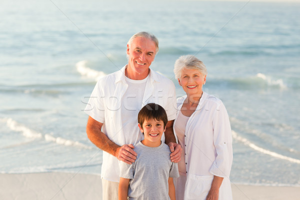 Grands-parents petit-fils plage femme famille coucher du soleil Photo stock © wavebreak_media