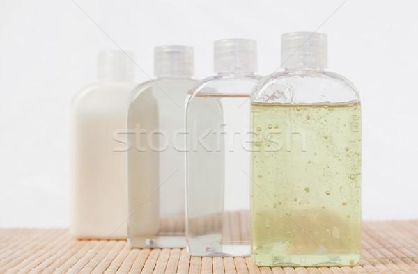 Olio da massaggio bottiglie donna fiore acqua Foto d'archivio © wavebreak_media