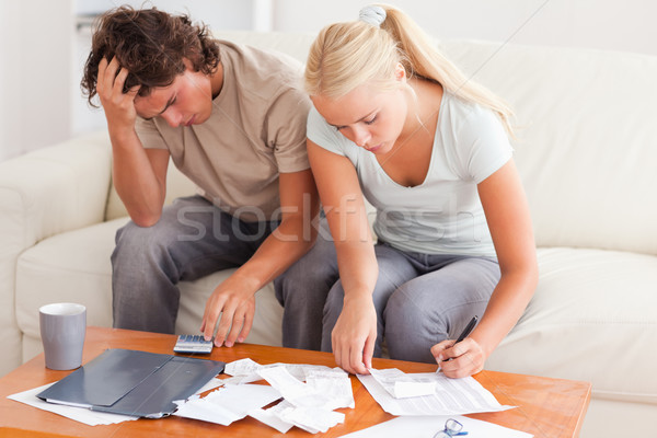 Worn out couple working together in the living room Stock photo © wavebreak_media