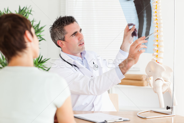 Male Doctor showing a patient a x-ray in a room Stock photo © wavebreak_media