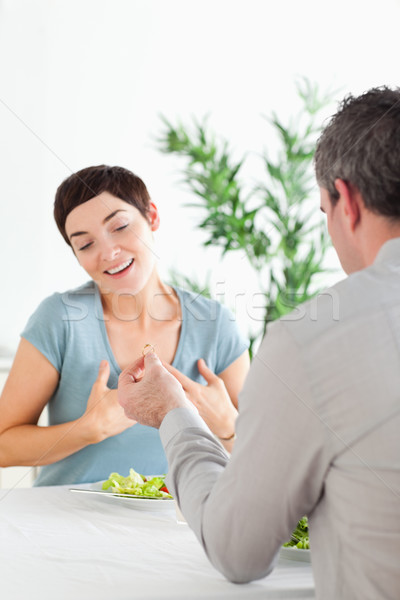 Man proposing to his amazed girlfriend during dinner in a restaurant Stock photo © wavebreak_media