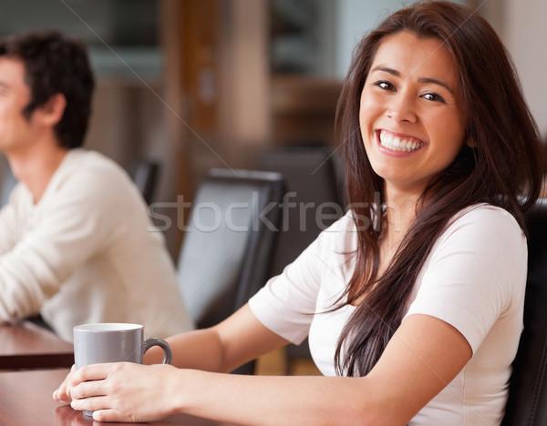 Happy woman having a coffee in a cafe Stock photo © wavebreak_media