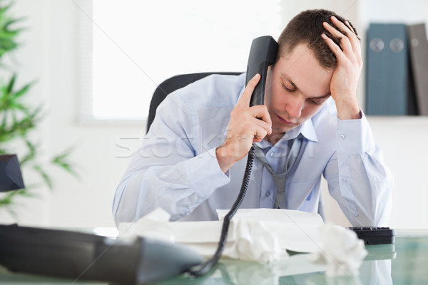 Frustrated businessman looking at an invoice while on the phone Stock photo © wavebreak_media