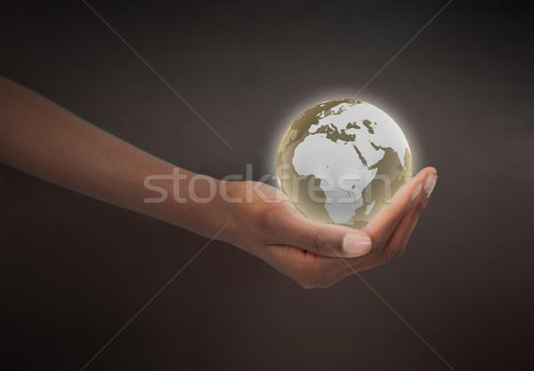 Feminino mão planeta globo escuro Foto stock © wavebreak_media