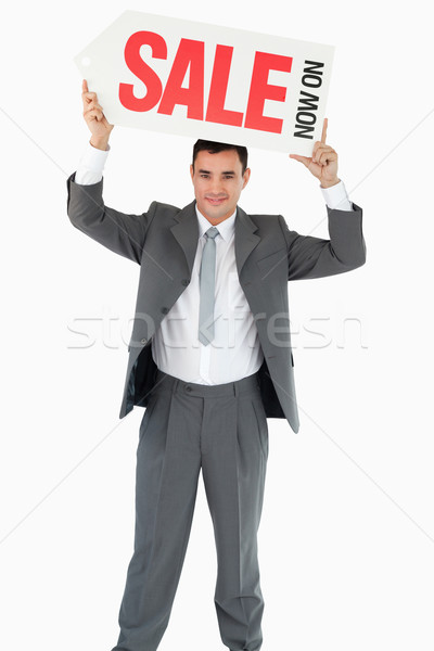 Businessman with sign above his head against a white background Stock photo © wavebreak_media