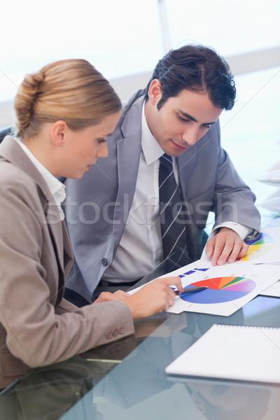 Portrait of business people studying statistics in a meeting room Stock photo © wavebreak_media