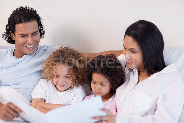 Happy young family enjoys reading a story together Stock photo © wavebreak_media