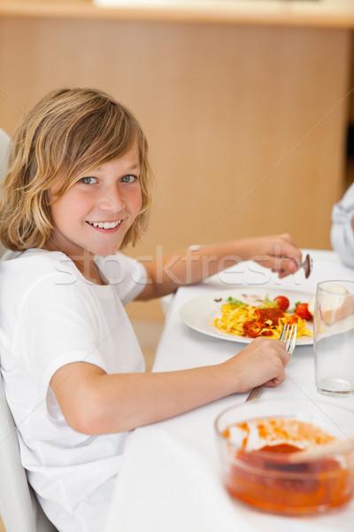 Yandan görünüş mutlu gülen erkek oturma yemek masası Stok fotoğraf © wavebreak_media