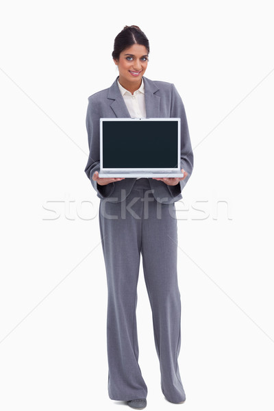 Smiling female entrepreneur presenting screen of her laptop against a white background Stock photo © wavebreak_media