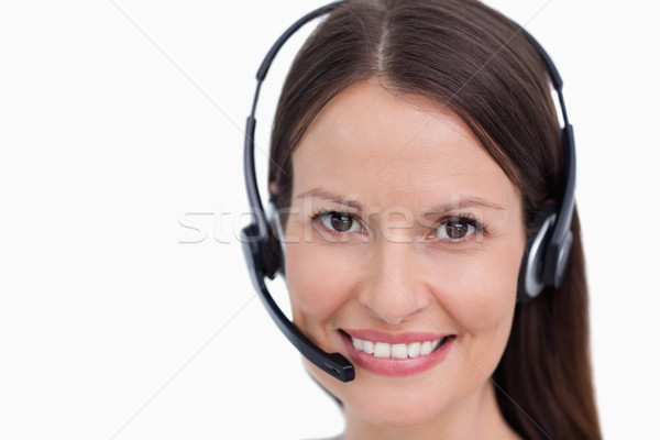 Close up of smiling female call center employee against a white background Stock photo © wavebreak_media