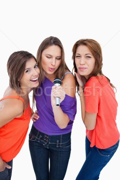 Drie aantrekkelijk tieners zingen microfoon Stockfoto © wavebreak_media