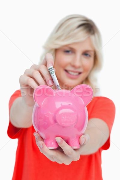 Notas rosa alcancía blanco cara Foto stock © wavebreak_media