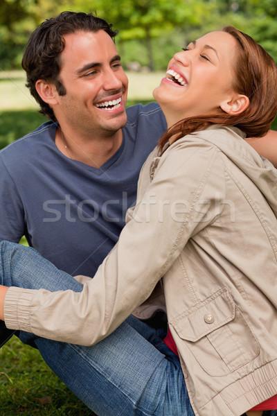 два друзей смеясь сидят другой землю Сток-фото © wavebreak_media