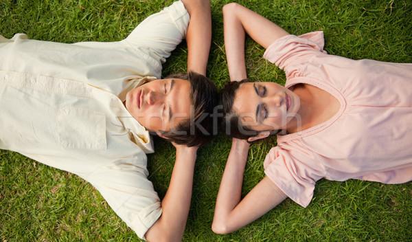 Man vrouw hoofd beide armen Stockfoto © wavebreak_media