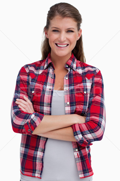 Portrait of a blissful woman with the arms crossed against a white background Stock photo © wavebreak_media