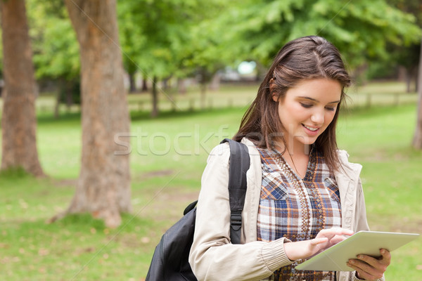 First-year student using a touch pad in a park Stock photo © wavebreak_media