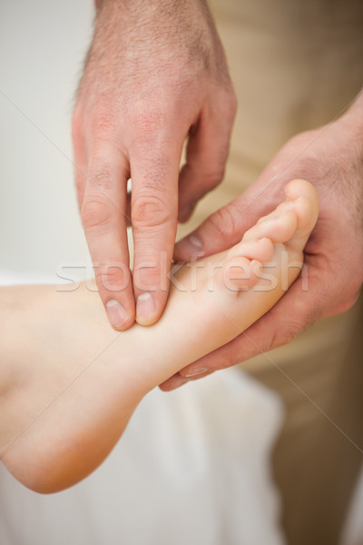 Two fingers palpating the muscles of a foot indoors Stock photo © wavebreak_media