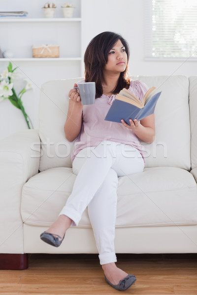 Woman drinking from a mug in a living room Stock photo © wavebreak_media
