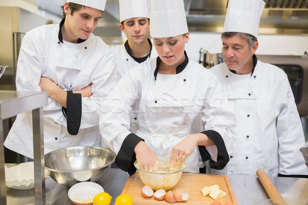 Stock photo: Culinary students learning how to mix dough in kitchen