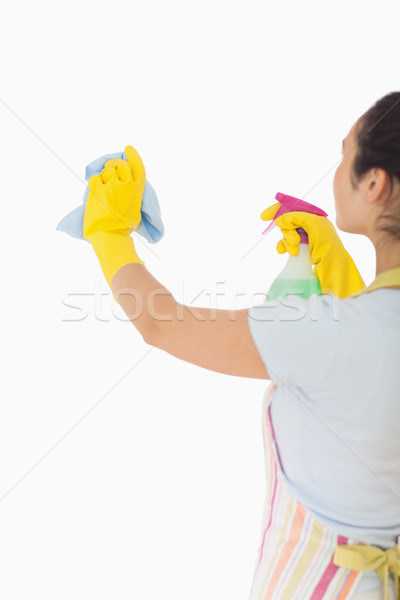 Woman cleaning wall with cloth and spray bottle Stock photo © wavebreak_media
