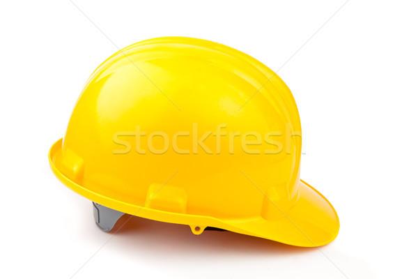 Yellow helmet lying against white background Stock photo © wavebreak_media