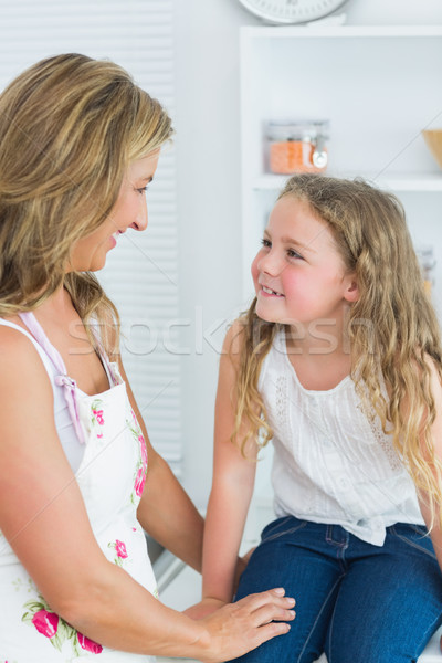 Smiling mother and daughter looking into each other's eyes Stock photo © wavebreak_media