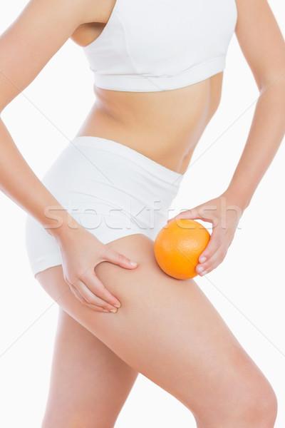Geschikt vrouw vet dij oranje witte Stockfoto © wavebreak_media