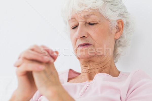 Woman saying her prayers Stock photo © wavebreak_media