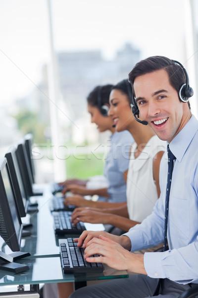 Joyful call centre agent working  Stock photo © wavebreak_media