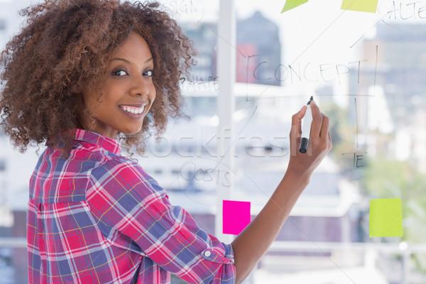 Nő rajz folyamatábra cetlik mosolyog kamera Stock fotó © wavebreak_media