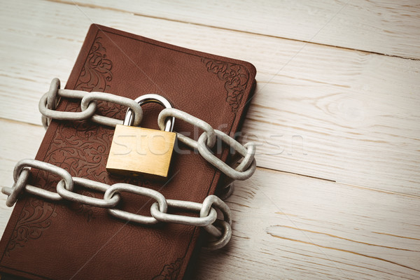 Open bible chained with lock Stock photo © wavebreak_media