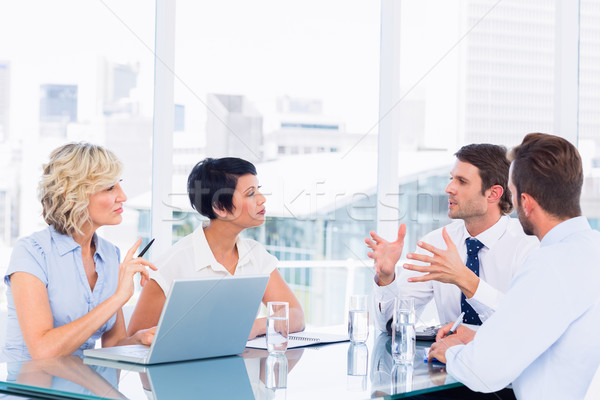 Executives sitting around conference table Stock photo © wavebreak_media