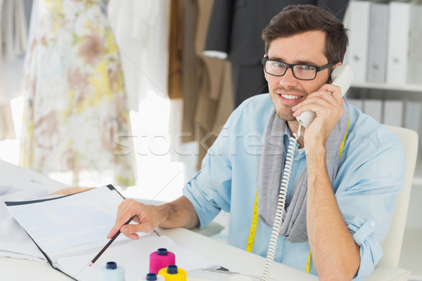 Smiling male fashion designer using phone Stock photo © wavebreak_media