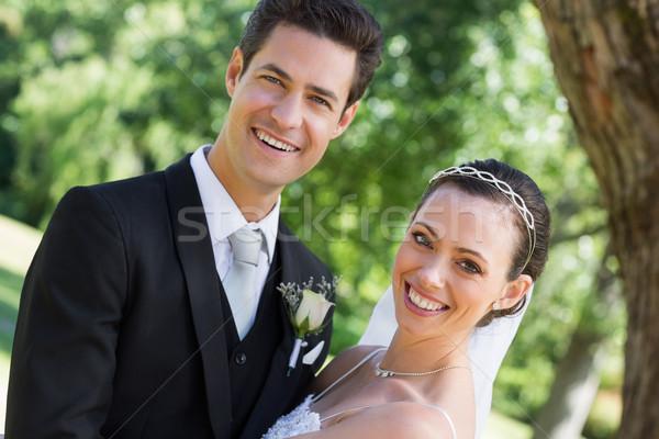 Happy young bride and groom in garden Stock photo © wavebreak_media