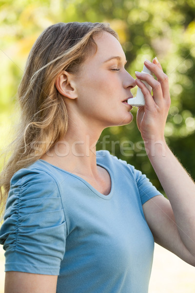 Young woman using asthma inhaler at park Stock photo © wavebreak_media