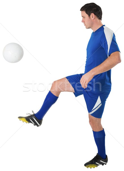 Football player in blue kicking Stock photo © wavebreak_media