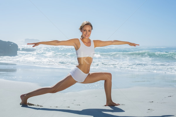 Gorgeous blonde in warrior pose by the sea Stock photo © wavebreak_media