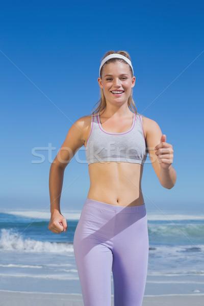 スポーティー 幸せ ブロンド ジョギング ビーチ ストックフォト © wavebreak_media