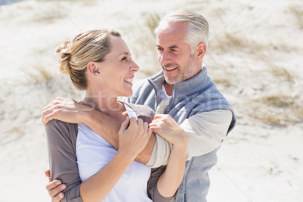Happy hugging couple on the beach looking at each other Stock photo © wavebreak_media