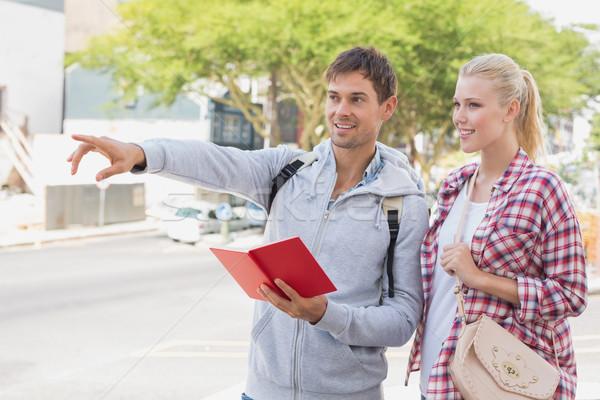молодые туристических пару Consulting направлять книга Сток-фото © wavebreak_media