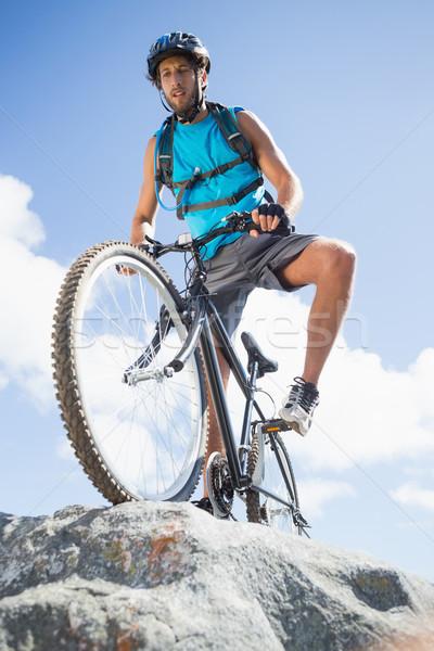 Caber homem ciclismo terreno montanha Foto stock © wavebreak_media