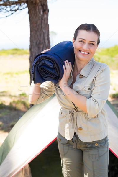 женщина улыбается камеры за пределами палатки женщину Сток-фото © wavebreak_media