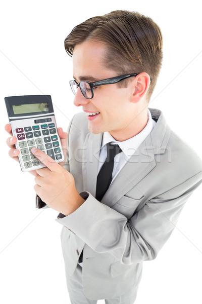 Uśmiechnięty biznesmen Kalkulator biały strony Zdjęcia stock © wavebreak_media