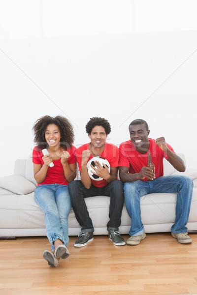 Calcio tifosi seduta divano insieme Foto d'archivio © wavebreak_media